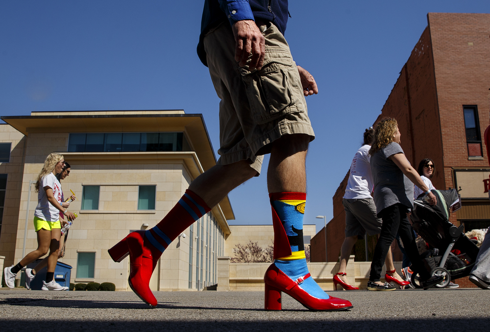 Jeff Woods accented his red heels with colorful socks during the 10th Annual Walk a Mile in Her Shoes event Saturday, April 16, 2016. Ted Schurter/The State Journal-Register