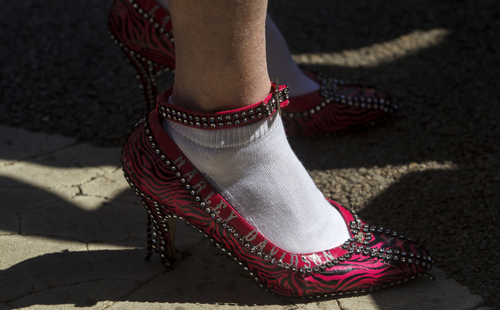 White cotton socks were the preferred barrier of choice to prevent bunions and blisters during 10th Annual Walk a Mile in Her Shoes event Saturday, April 16, 2016. About 250 people, many of them men in high heel shoes, participated in the walk to help raise funds for the Prairie Center Against Sexual Assault. Ted Schurter/The State Journal-Register
