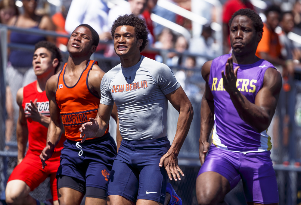 New Berlin's Kahlil Wassell, center, finished second to Bloomington's Cary Lockhart, right, in the 100m Dash with a time of 11.41 during the Capital City Classic track and field meet at Memorial Stadium, Saturday, April 16, 2016, in Springfield, Ill. Justin L. Fowler/The State Journal-Register