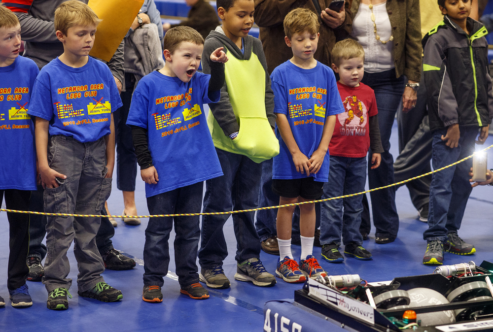 Liam Alton points to the target as a robot created by the Ninjaneers, team 4156, prepares to fire a ball toward it during an exhibition at the  Central Illinois Junior FIRST LEGO League Expo in Cass Gymnasium at Lincoln Land Community College Sunday, April 10, 2016. Ted Schurter/The State Journal-Register