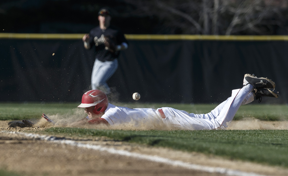 Glenwood's Karson Aherin beats the throw as he slides into third base against Sacred Heart-Griffin in the fourth inning at Chatham Community Park, Thursday, April 14, 2016, in Chatham, Ill. Justin L. Fowler/The State Journal-Register