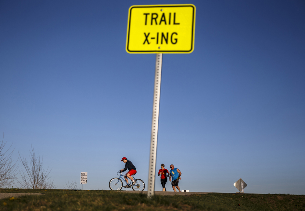 Pedestrians and cyclists take advantage of the warmer temperatures and clear skies on the Sangamon Valley Trail, Thursday, April 14, 2016, in Springfield, Ill. Users of the area bike and hike trails could soon see signs pointing out nearby businesses as part of a new sponsorship plan to be used for trail maintenance. Justin L. Fowler/The State Journal-Register