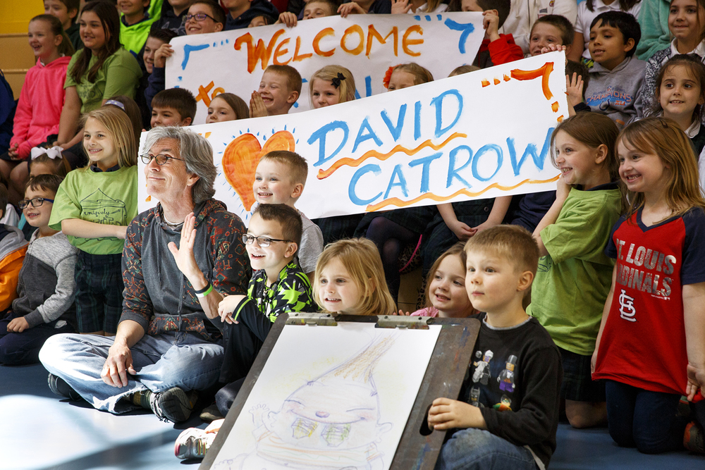 Childrens book author and illustrator David Catrow poses for a picture with St. Aloysius students during a visit to the school Tuesday, April 12, 2016. Rich Saal/The State Journal-Register