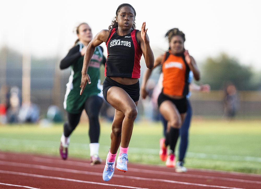 Springfield's Ozzy Erewele takes the lead heading to the finish line to win the Girls 100m Dash during the Co-Ed Titan Invite at Glenwood High School, Friday, April 22, 2016, in Chatham, Ill. Justin L. Fowler/The State Journal-Register