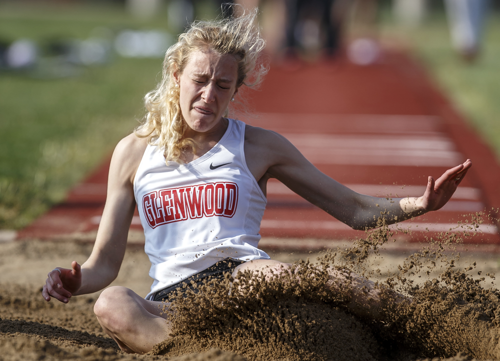 Glenwood's Alison Woerner hits the sand while competing in the Girls Long Jump during the Co-Ed Titan Invite at Glenwood High School, Friday, April 22, 2016, in Chatham, Ill. Woerner won the event with a jump of 18-3.5. Justin L. Fowler/The State Journal-Register