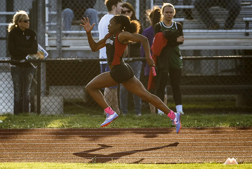 Springfield's Ozzy Erewele heads to the finish line in the final leg of the Girls 4x100m Relay to take the victory for the Senators during the Co-Ed Titan Invite at Glenwood High School, Friday, April 22, 2016, in Chatham, Ill. Justin L. Fowler/The State Journal-Register