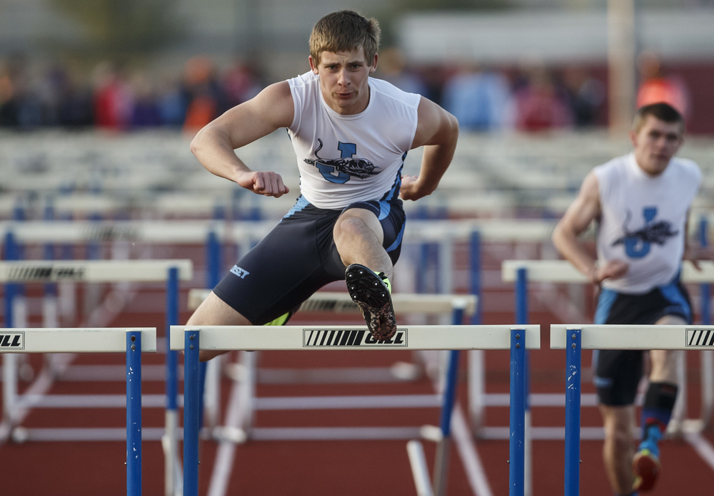 Jerseyville's Mitch Goetten takes home the victory in the Boys 110m Hurdles during the Co-Ed Titan Invite at Glenwood High School, Friday, April 22, 2016, in Chatham, Ill. Justin L. Fowler/The State Journal-Register