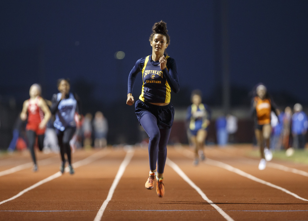 Southeast's Alexis Henry takes a commanding lead into the finish line to win the Girls 400m Dash during the Co-Ed Titan Invite at Glenwood High School, Friday, April 22, 2016, in Chatham, Ill. Justin L. Fowler/The State Journal-Register