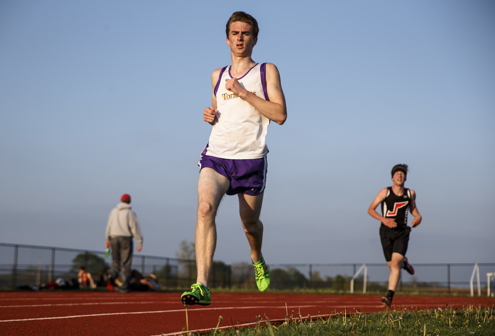 Taylorville's Luke Sloan takes the lead from Jacksonville's Jacob Moberly to win the Boys 3200m Run during the Co-Ed Titan Invite at Glenwood High School, Friday, April 22, 2016, in Chatham, Ill. Justin L. Fowler/The State Journal-Register