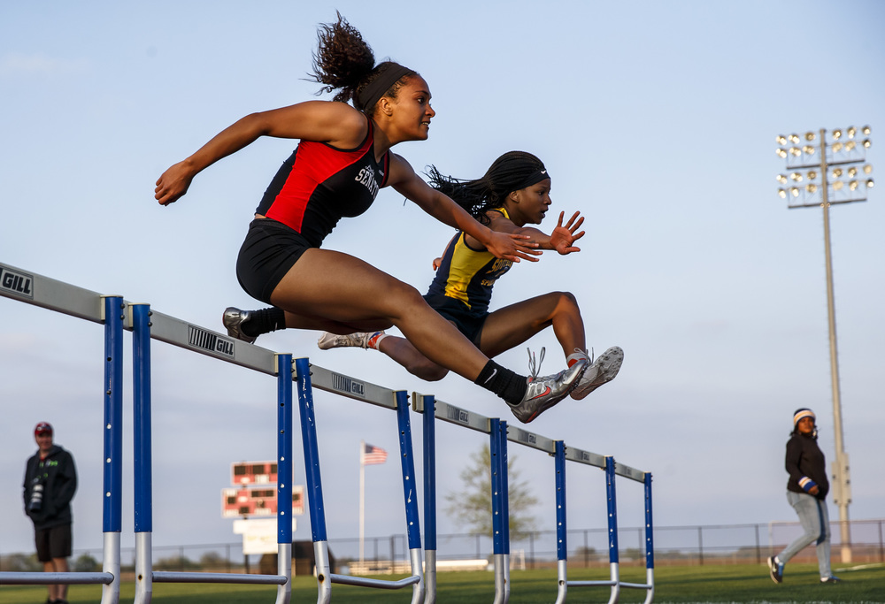 Southeast's Dontavia Howard edges out Springfield's Kyra Webster, left, to win the Girls 100m Hurdles during the Co-Ed Titan Invite at Glenwood High School, Friday, April 22, 2016, in Chatham, Ill. Justin L. Fowler/The State Journal-Register