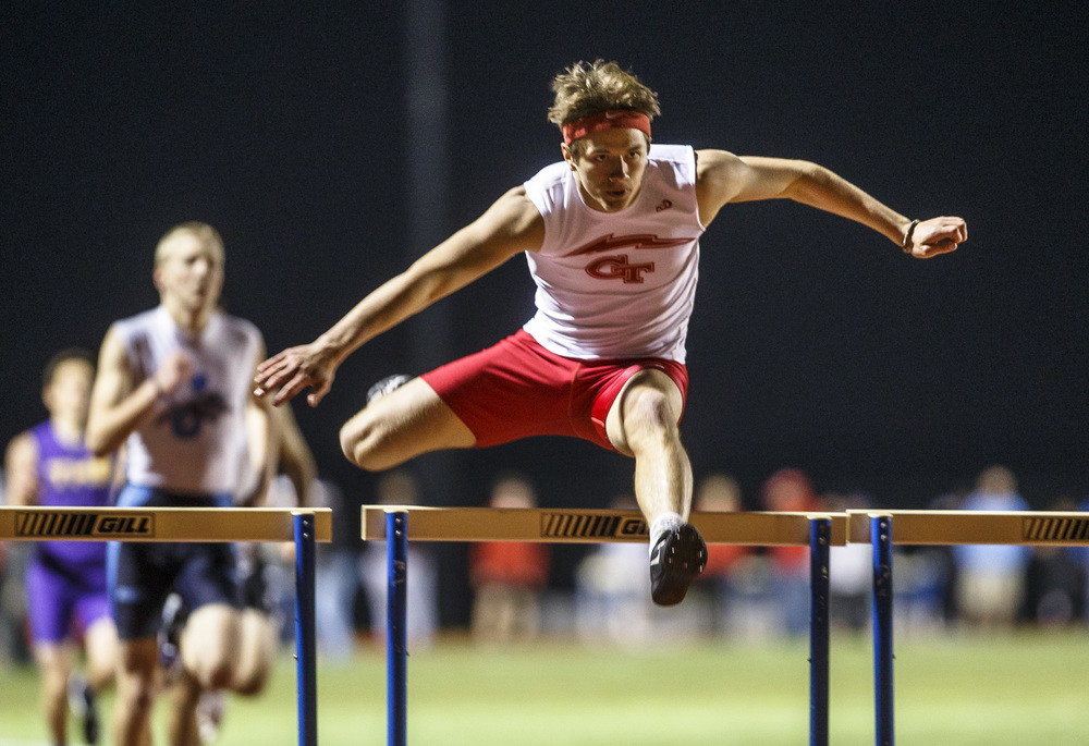 Glenwood's Robbie Hansen wins the Boys 300m Hurdles during the Co-Ed Titan Invite at Glenwood High School, Friday, April 22, 2016, in Chatham, Ill. Justin L. Fowler/The State Journal-Register