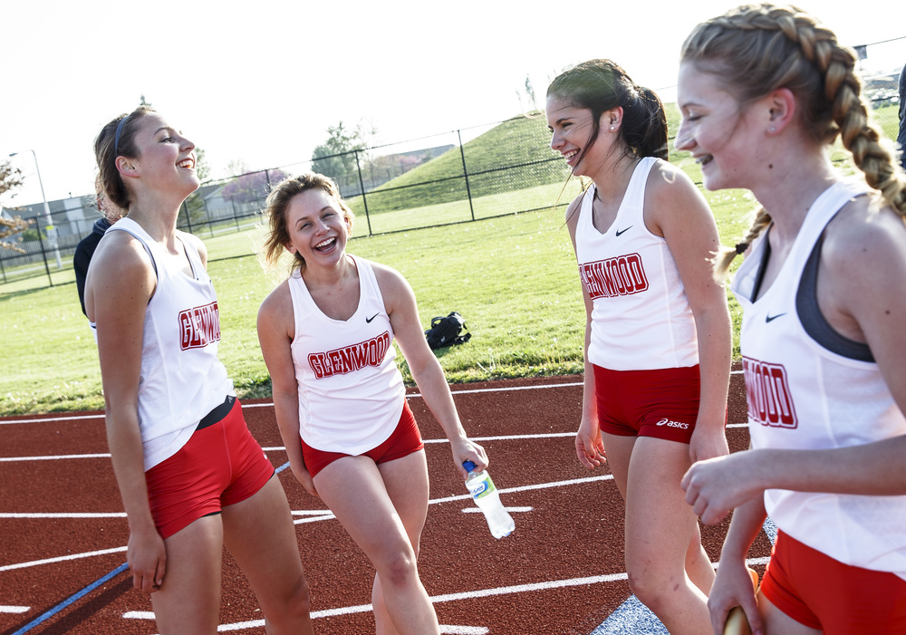 The Glenwood Girls 4x800m Relay team celebrate after taking home the victory with a time of 10:11.46 during the Co-Ed Titan Invite at Glenwood High School, Friday, April 22, 2016, in Chatham, Ill. Justin L. Fowler/The State Journal-Register