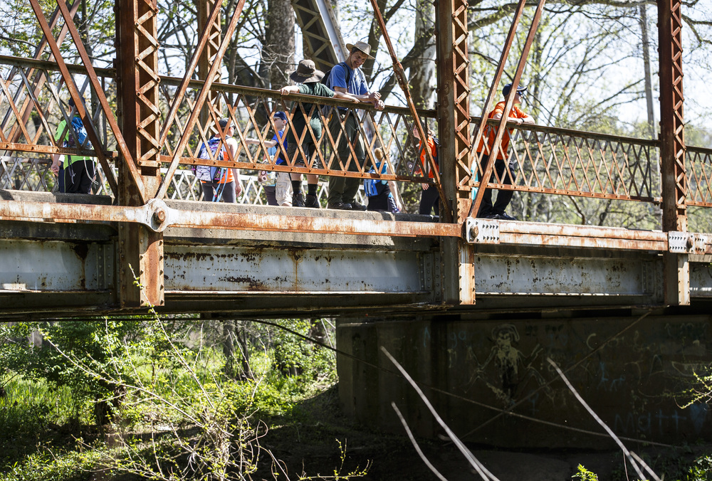 Boy Scouts and the leaders stop to enjoy the view on the bridge over Richland Creek on Irwin Bridge Road during the Lincoln Trail Hike from the New Salem State Historic Site to Stuart Park, Saturday, April 23, 2016, north of Springfield, Ill. Justin L. Fowler/The State Journal-Register