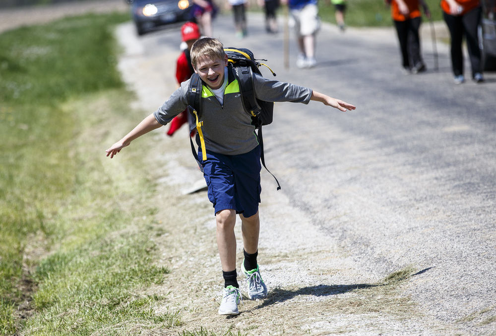 "Roger Uhe with Boy Scout Troop 215 spreads out his arms as he prepares to hit the ground as he comes into the checkpoint five miles from the finish during the Lincoln Trail Hike from the New Salem State Historic Site to Stuart Park, Saturday, April 23, 2016, north of Springfield, Ill. ""This last stretch has been pretty tough,"" said Uhe. Justin L. Fowler/The State Journal-Register"