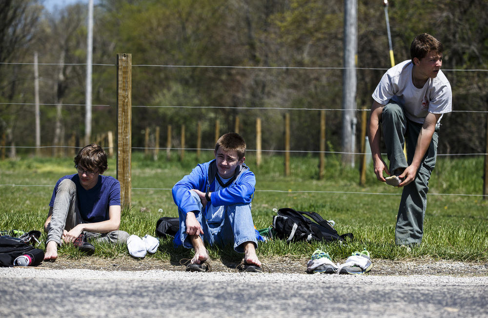 Colton Hampson, left, Austin Dulceak and Noah Fons, right, of Chatham Boy Scout Troop 310 take a break and switch out their socks at a checkpoint fives miles from the finish during the Lincoln Trail Hike from the New Salem State Historic Site to Stuart Park, Saturday, April 23, 2016, north of Springfield, Ill. Justin L. Fowler/The State Journal-Register