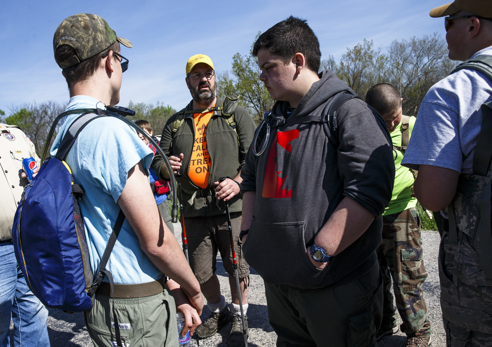 "Scout Master Greg Juergens of Lewiston Boy Scout Troop 132 rallies his troop as he reminds them they are a team and to work together before setting back out on the trail during the Lincoln Trail Hike from the New Salem State Historic Site to Stuart Park, Saturday, April 23, 2016, in Salisbury, Ill. ""We've got a few little injuries, a few blisters and a rolled ankle,"" said Juergens as he and his scouts stopped at the Salisbury Christian Church for a break. Justin L. Fowler/The State Journal-Register"