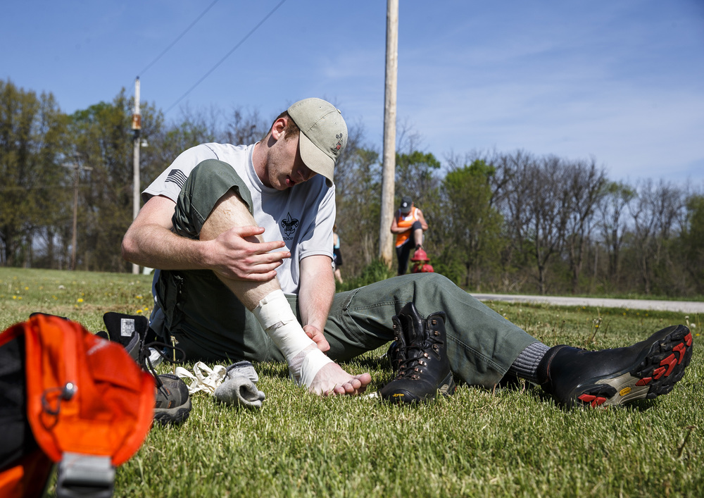 Eagle Scout Noah Kren of Blessed Sacrement Boy Scout Troop 31 patched up a blister while stopped for a break at Salisbury Christian Church during the Lincoln Trail Hike from the New Salem State Historic Site to Stuart Park, Saturday, April 23, 2016, in Salisbury, Ill. Justin L. Fowler/The State Journal-Register