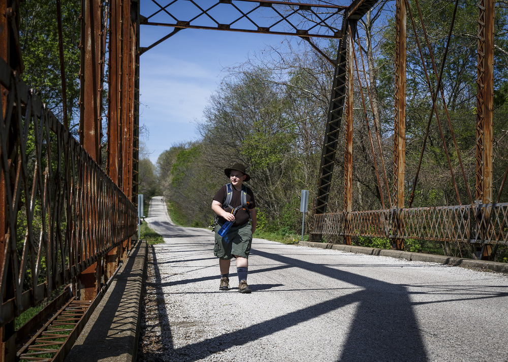 Zachariah Ranson of Auburn Boy Scout Troop 340 crosses the bridge over Richland Creek on Irwin Bridge Road during the Lincoln Trail Hike from the New Salem State Historic Site to Stuart Park, Saturday, April 23, 2016, in , Ill. Justin L. Fowler/The State Journal-Register