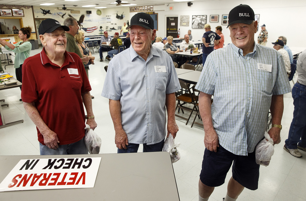 Brothers and Army veterans, from left, Jerry, Howard and Don Bull check in at the Northenders VFW Post 10302 in anticipation of their Land of Lincoln Honor Flight that departs Tuesday, April 19, 2016. The brothers and 76 other veterans will visit the National World War II Memorial, the Vietnam Veterans Memorial and other military sites before returning to Springfield. Ted Schurter/The State Journal-Register