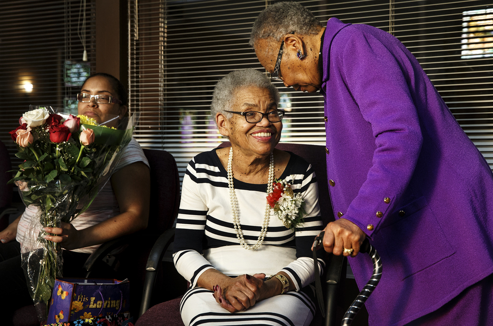Betty Jean Beard visits with her long-time friend Mary Hooks after a ceremony in her honor at St. Paul A.M.E. Church Sunday, April 17, 2016. Beard, a member of the church since the 1960's, was recognized for her work in the church community. Ted Schurter/The State Journal-Register