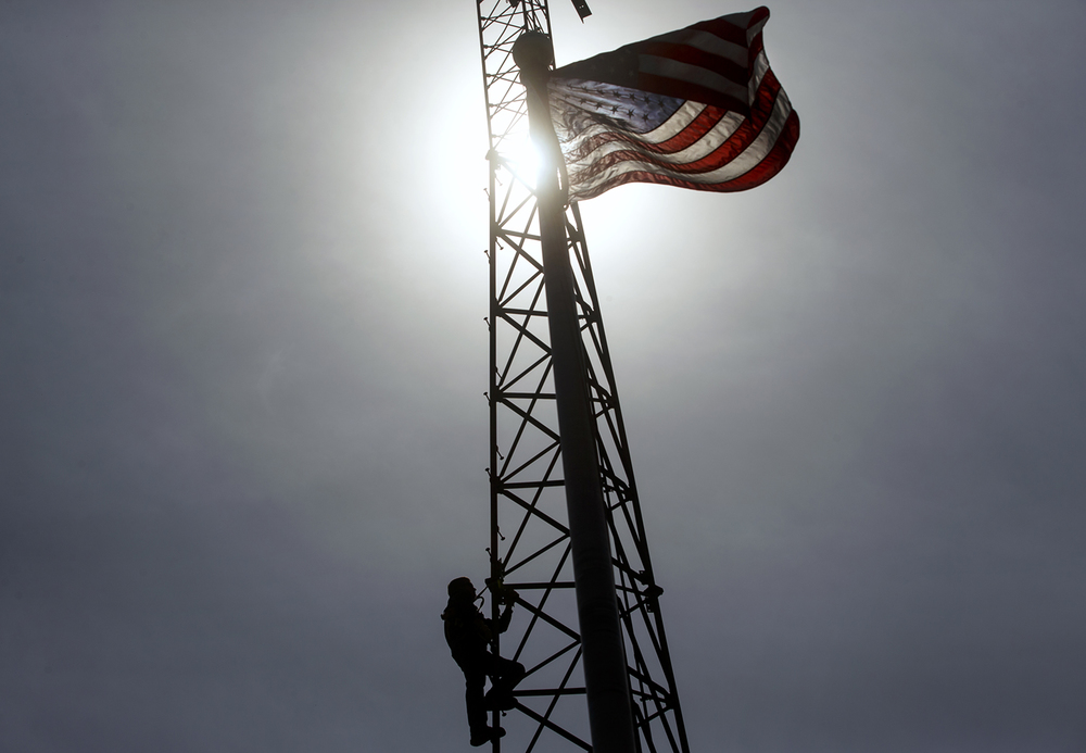 Progressive Electric employee Albert Hohimer climbs down a light tower at Chamberlain Ball Park Field Monday, April 18, 2016. Hohimer said he enjoys the view while he's up that high changing light bulbs or ballasts and cleaning the fixtures. Ted Schurter/The State Journal-Register