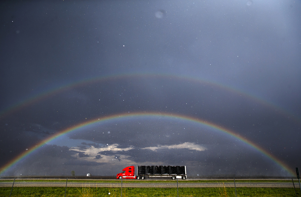 A tractor-trailer travels northbound on I-55 as the sun illuminates a double rainbow across the sky as storm showers move through the area just south of Divernon, Ill, Thursday, April 21, 2016. Justin L. Fowler/The State Journal-Register