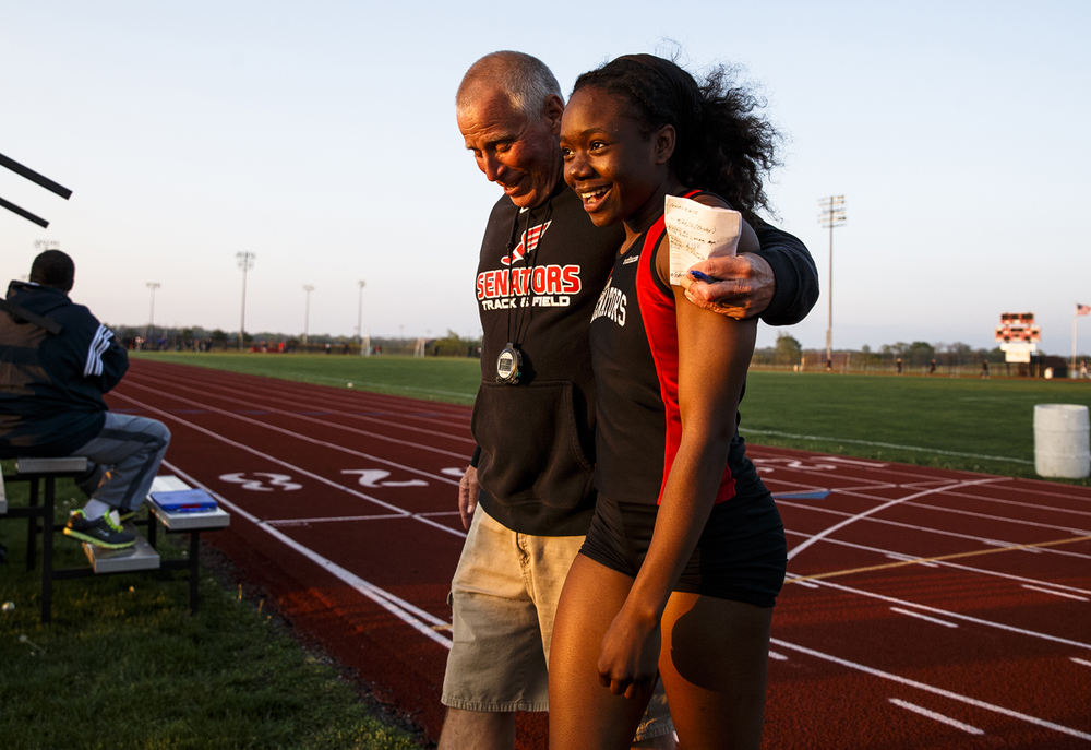 Springfield's Ozzy Erewele walks off the track with a hug from head coach Eric Warren after winning the Girls 100m Dash during the Co-Ed Titan Invite at Glenwood High School, Friday, April 22, 2016, in Chatham, Ill. Justin L. Fowler/The State Journal-Register