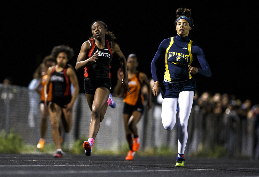 Springfield'S Ozzy Erewele pulls even with Southeast's Jamari Drake as they head into the finish line in 200m Dash with Erewele getting the victory during the Girls City track and field meet at Southeast High School, Thursday, April 28, 2016, in Springfield, Ill. Erewele and Drake competed against each other in the 100m Dash, 200m Dash and in the final leg of the 4x100m Relay. Justin L. Fowler/The State Journal-Register