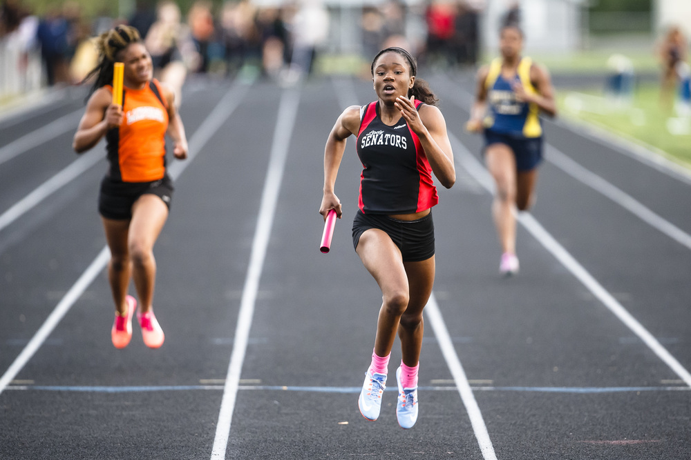Springfield Ozzy Erewele erased a lead by Lanphier's Dejuana Cooper on the final leg of the 4x200m Relay to win the race for the Senators during the Girls City track and field meet at Southeast High School, Thursday, April 28, 2016, in Springfield, Ill. Justin L. Fowler/The State Journal-Register