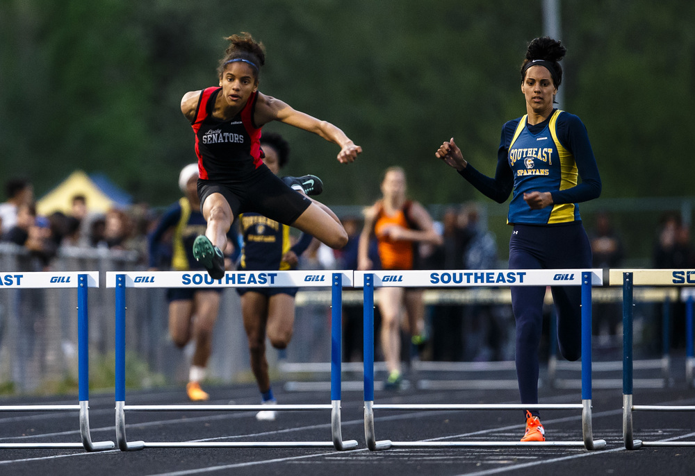 Springfield's Lauren Ferguson, left, takes the lead over the final hurdle to win the 300m Hurdles during the Girls City track and field meet at Southeast High School, Thursday, April 28, 2016, in Springfield, Ill. Justin L. Fowler/The State Journal-Register