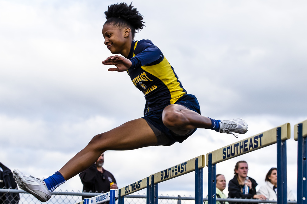 Southeast's Dontavia Howard clears the final hurdle in the lead to win the 100m Hurdles during the Girls City track and field meet at Southeast High School, Thursday, April 28, 2016, in Springfield, Ill. Justin L. Fowler/The State Journal-Register