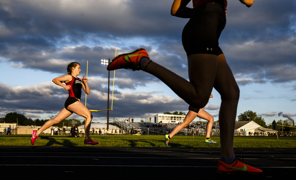 Springfield's Abby Norris, left, rounds the turn on the opening lap of the 1600m Run during the Girls City track and field meet at Southeast High School, Thursday, April 28, 2016, in Springfield, Ill. Justin L. Fowler/The State Journal-Register
