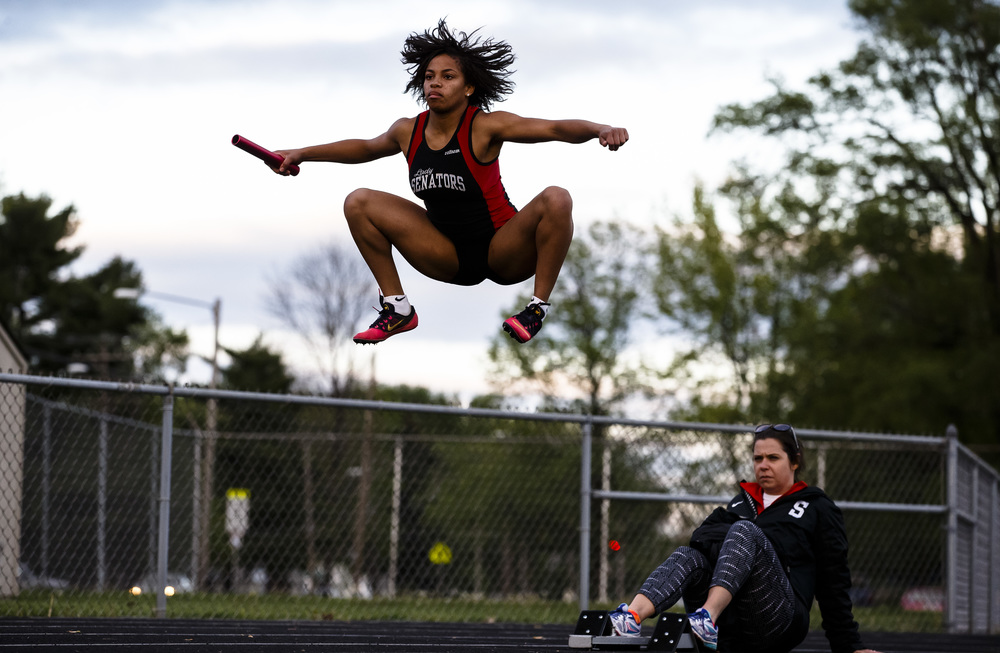 Springfield's Hannah Burnes leaps into the air as she gets ready to run the first leg of the 4x200m Relay during the Girls City track and field meet at Southeast High School, Thursday, April 28, 2016, in Springfield, Ill. Justin L. Fowler/The State Journal-Register