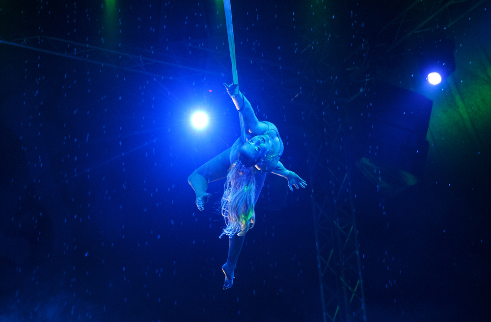 "Morgaine Rosenthal performs her straps routine as a mermaid during an afternoon performance of ""Aquatic Spectacular"" by the Cirque Italia Sunday, May 1, 2016. The travelling show features a 35,000 gallon water stage, colorful water curtain and dancing fountains. Ted Schurter/The State Journal-Register"
