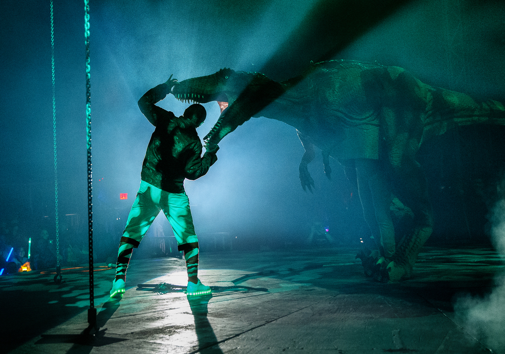 "Alex Acero sticks his head inside a dinosaur's mouth during an afternoon performance of ""Aquatic Spectacular"" by the Cirque Italia Sunday, May 1, 2016. The travelling show features a 35,000 gallon water stage, colorful water curtain and dancing fountains. Ted Schurter/The State Journal-Register"