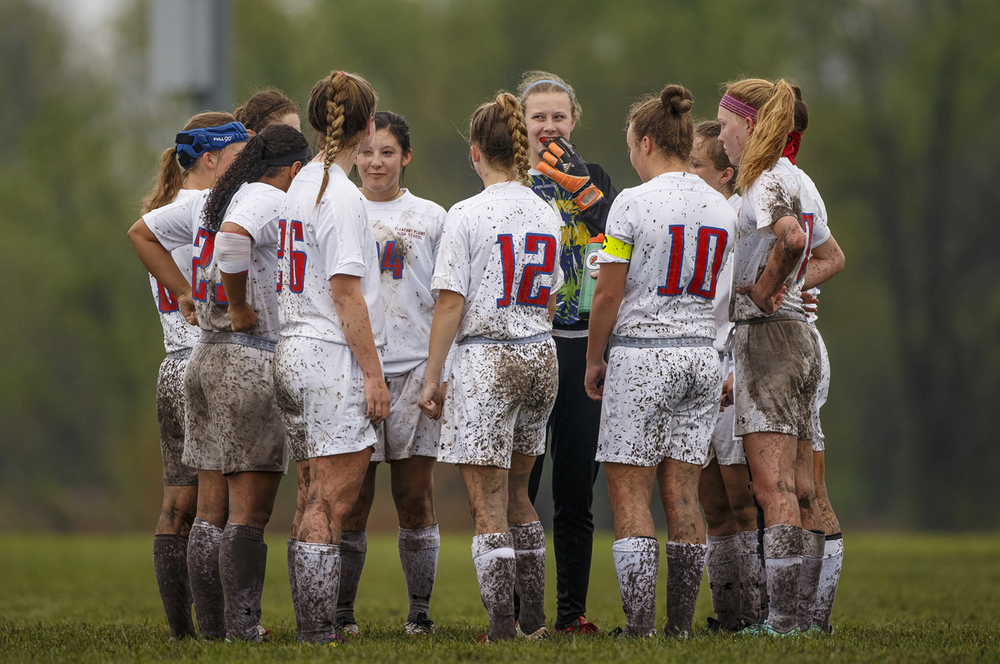 The mud-splattered Pleasant Plains Cardinals gather at halftime as they face Williamsville during the title game of the Pleasant Plains Invitational girls soccer tournament Saturday, April 30, 2016. Ted Schurter/The State Journal-Register