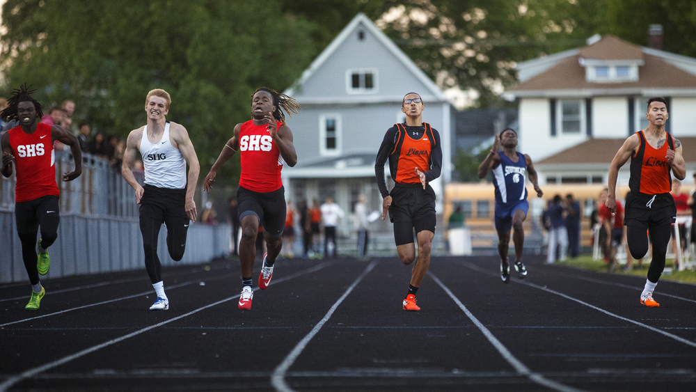 Springfield's Wendel Burnes edges Lanphier's Dearis Herron in the 200 meter dash during the Boys City Track Meet at Memorial Stadium Tuesday, May 3, 2016. Ted Schurter/The State Journal-Register