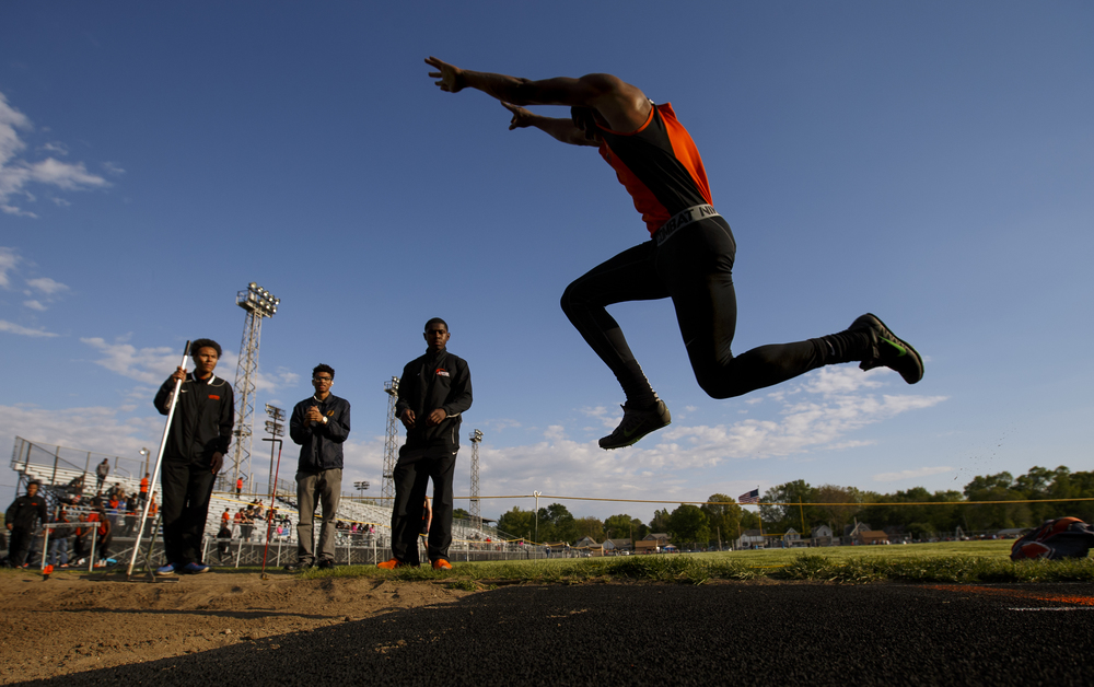 Lanphier's Rudy Ester wins the triple jump during the Boys City Track Meet at Memorial Stadium Tuesday, May 3, 2016. Ted Schurter/The State Journal-Register