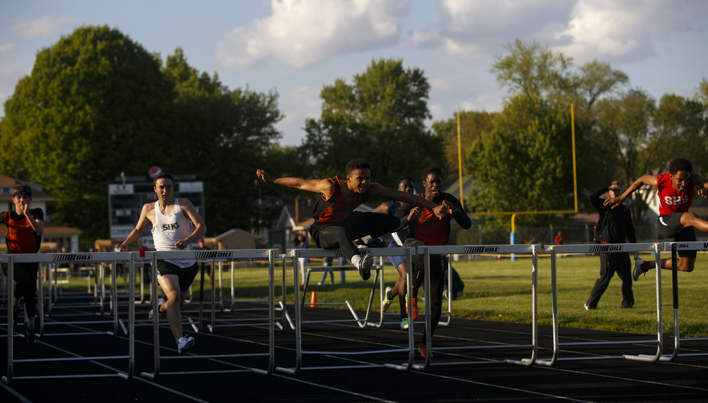 Lanphier's Cameron Smith wins the 110 meter hurdles during the Boys City Track Meet at Memorial Stadium Tuesday, May 3, 2016. Ted Schurter/The State Journal-Register