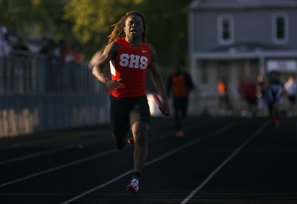 Springfield's Wendel Burnes finishes first in his heat and second in the 200 meter dash during the Boys City Track Meet at Memorial Stadium Tuesday, May 3, 2016. Ted Schurter/The State Journal-Register