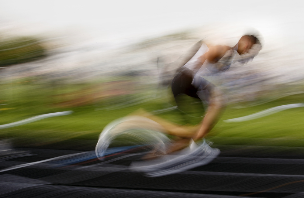 Sacred Heart-Griffin's Tristan Blair becomes a blur of color and form during this long exposure pan photograph from the start of the 400 meter dash during the Boys City Track Meet at Memorial Stadium Tuesday, May 3, 2016. Ted Schurter/The State Journal-Register