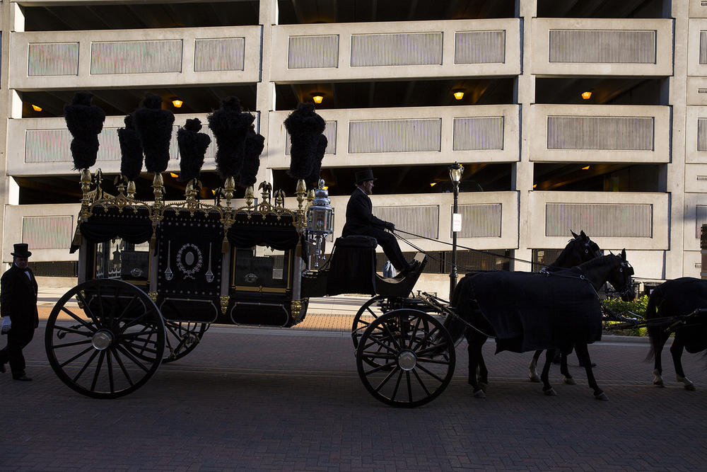 The Lincoln funeral hearse moves west on Capitol Avenue during a commemoration of the 151st anniversary of Abraham Lincoln's funeral with a march from the Old State Capitol Historic Site to Oak Ridge Cemetery. Rich Saal/The State Journal-Register