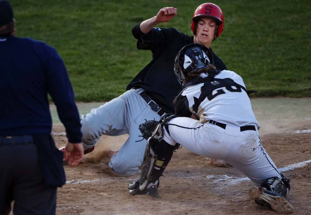 Sacred Heart-Griffin's Jake Shea tags out Springfield's Ethan Klay in the first inning during the City Series at Robin Roberts Stadium Wednesday, May 4, 2016. Ted Schurter/The State Journal-Register