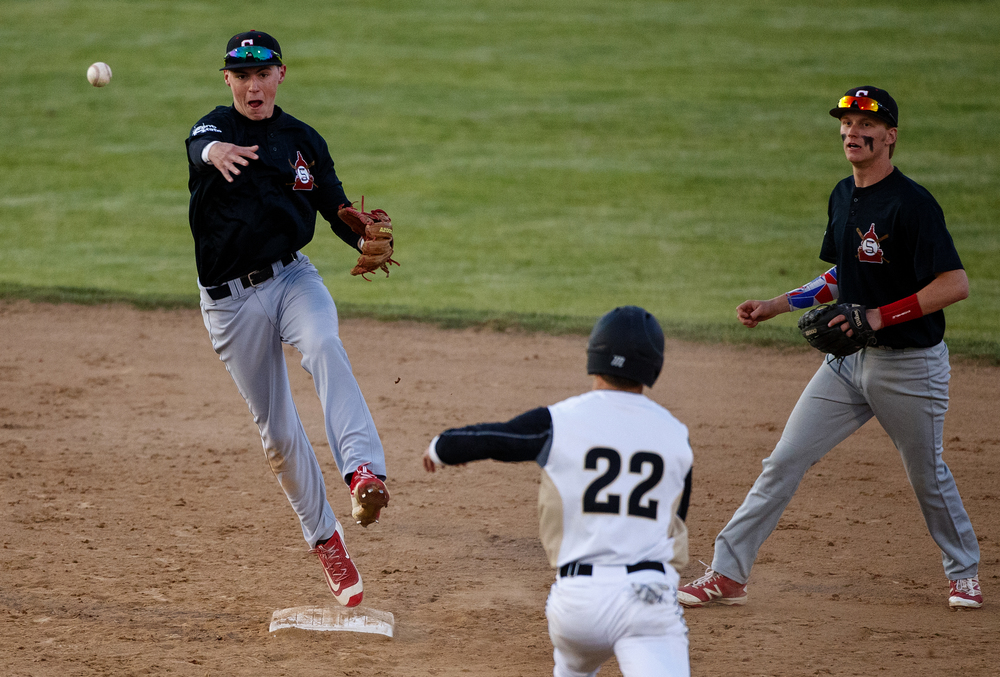 Springfield's Trevor Minder fires to first to complete a double play aginst Sacred Heart-Griffin during the City Series at Robin Roberts Stadium Wednesday, May 4, 2016. Ted Schurter/The State Journal-Register