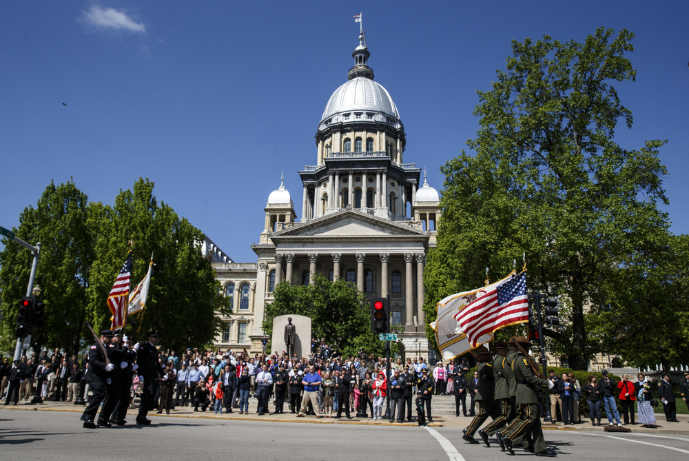 Police Honor Guards from throughout the state march down Second Street on their way to the Police Memorial during the 31st annual Police Officer Memorial Day at the Illinois State Capitol, Thursday, May 5, 2016, in Springfield, Ill. Justin L. Fowler/The State Journal-Register
