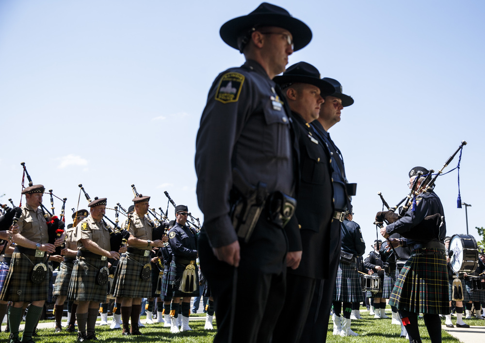 Pipe and Drum units from multiple law enforcement agencies perform Amazing Grace during the 31st annual Police Officer Memorial Day on the grounds of the Illinois State Capitol, Thursday, May 5, 2016, in Springfield, Ill. Justin L. Fowler/The State Journal-Register