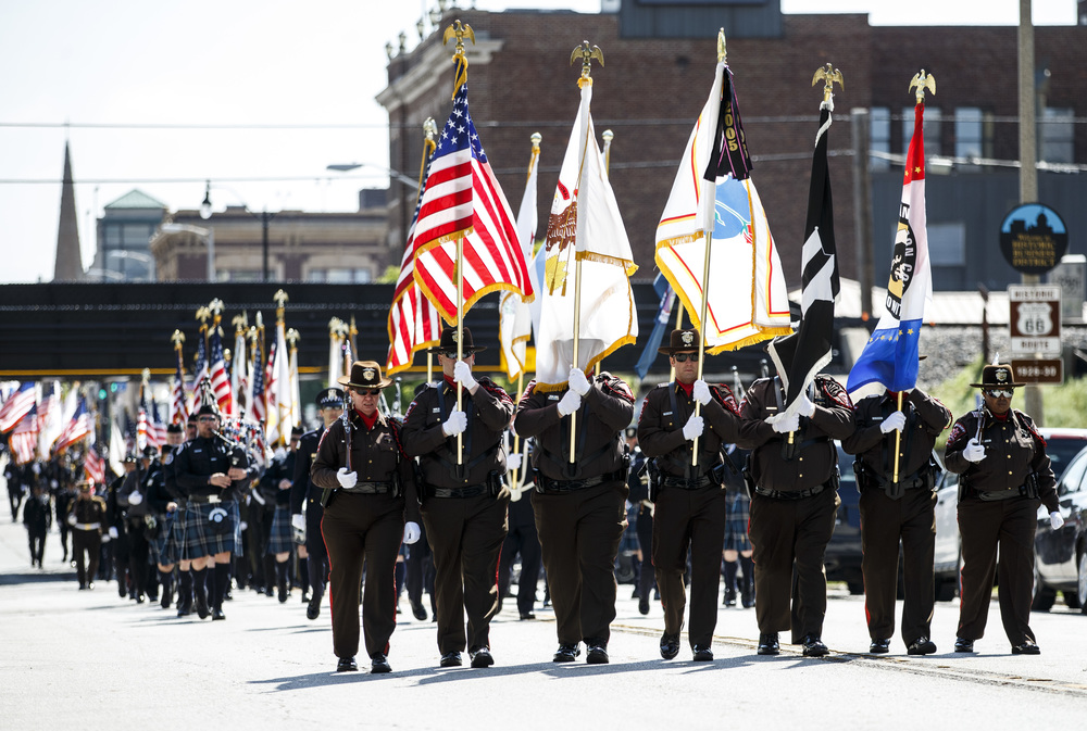 The Sangamon County Sheriff's Office Honor Guard leads the line of 22 law enforcement honor guards marching down Capitol Avenue on their way to the Police Memorial during the 31st annual Police Officer Memorial Day at the Illinois State Capitol, Thursday, May 5, 2016, in Springfield, Ill. Justin L. Fowler/The State Journal-Register