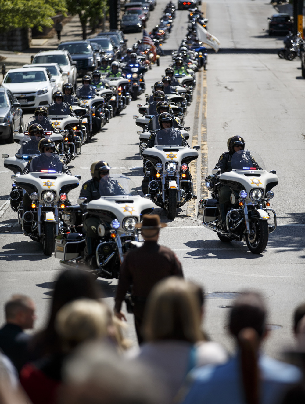 The motorcade of motorcycles lead by the Illinois State Police make their way down Capitol Avenue during the 31st annual Police Officer Memorial Day at the Illinois State Capitol, Thursday, May 5, 2016, in Springfield, Ill. Justin L. Fowler/The State Journal-Register