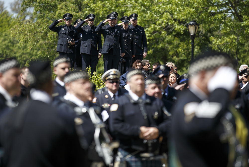 Police officers find a high point to look out over the field of law enforcement from across the state as they salute during the National Anthem during the 31st annual Police Officer Memorial Day on the grounds of the Illinois State Capitol, Thursday, May 5, 2016, in Springfield, Ill. Justin L. Fowler/The State Journal-Register