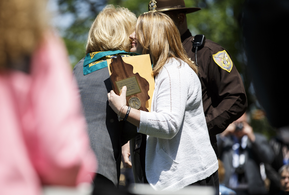Steffany Whisenand, the wife of the late Tazewell County Deputy Craig Whisenand who was killed in a car accident while responding to a domestic call, gets a hug from Comptroller Leslie Munger during the 31st annual Police Officer Memorial Day on the grounds of the Illinois State Capitol, Thursday, May 5, 2016, in Springfield, Ill. Justin L. Fowler/The State Journal-Register